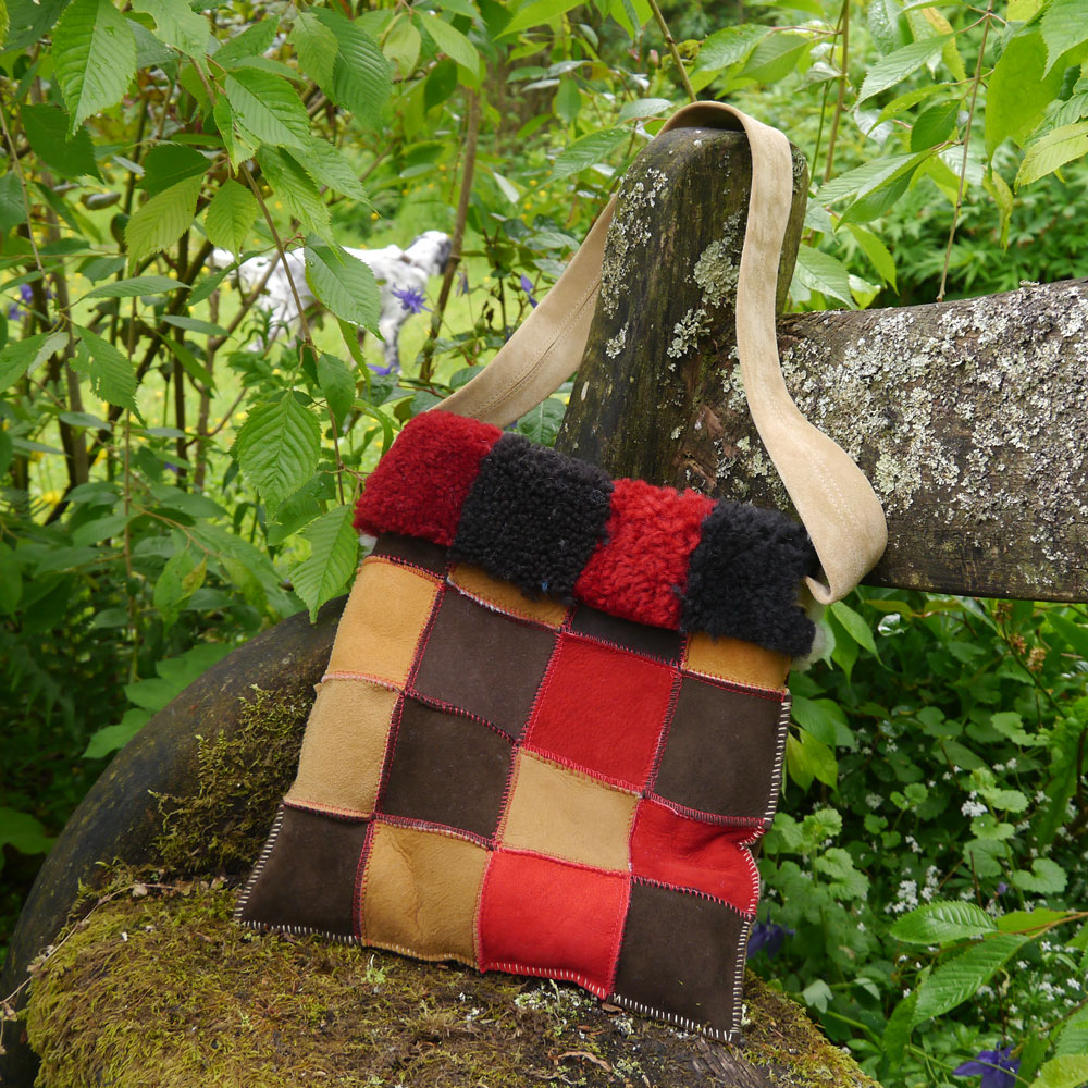 Sheepskin Bag in Mocca Red and Spice on reverse side of autumn