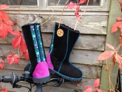 Calf height sheepskin boots in black with embroidered braid