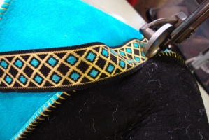 Work in progress - Sheepskin Bag in Black and Turquoise with embroidered braid